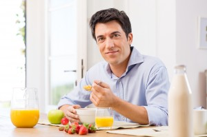 Portrait Of Happy Young Man Having Healthy Breakfast